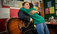 A student giving a teacher a hug