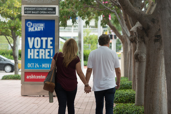 Voters exited a polling place during early voting in late October 2016 in Miami. President Trump won Florida by 1.2 percentage points.