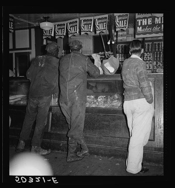 Coal miners buying supplies in company store. Scotts Run, West Virginia