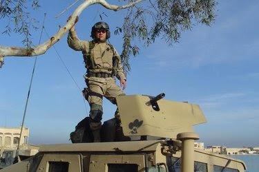 Capt. Christopher Van Meter in Iraq. Now a teacher in Modesto, Calif., he is repaying $46,000.