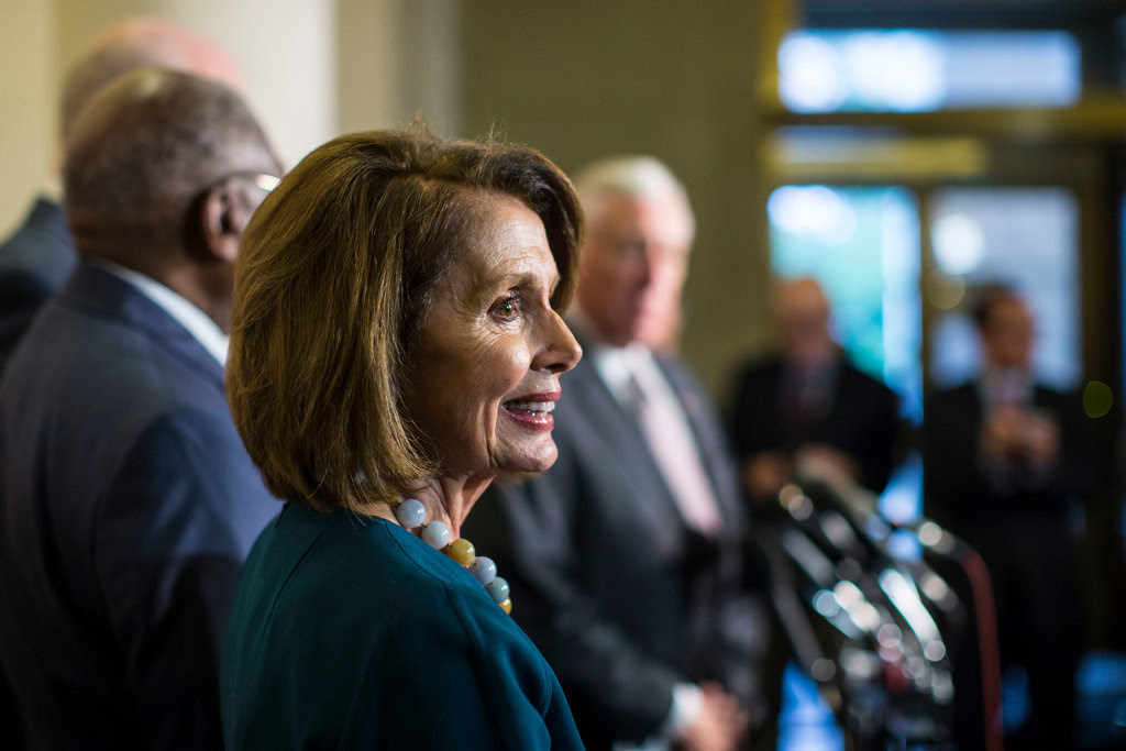 Representative Nancy Pelosi of California was re-elected the House minority leader on Wednesday.