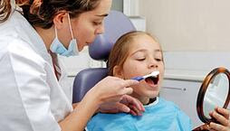 Child at the dentist. Link takes you to Medplus page on children's dental health month.