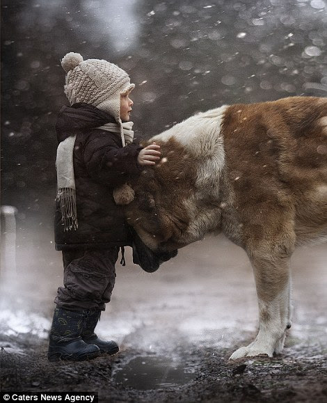 One of Mrs Shumilova's children with a dog