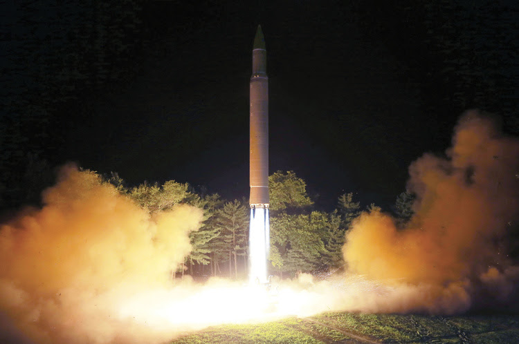 "This July 28 photo distributed by the North Korean government  shows what was said to be the launch of a Hwasong-14 intercontinental ballistic missile at an undisclosed location in North Korea. North Korea said Monday it will launch ""thousands-fold"" revenge against the United States over the adoption of tough U.N. sanctions imposed after its intercontinental ballistic launches. (Korean Central News Agency/Korea News Service/AP)"