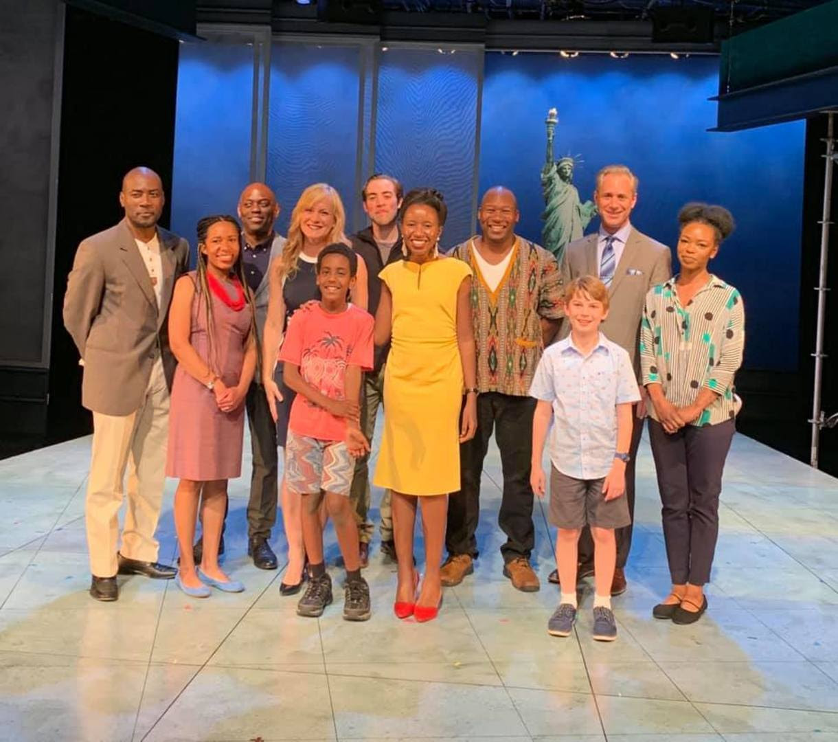 Cast with author Imbolo Mbue