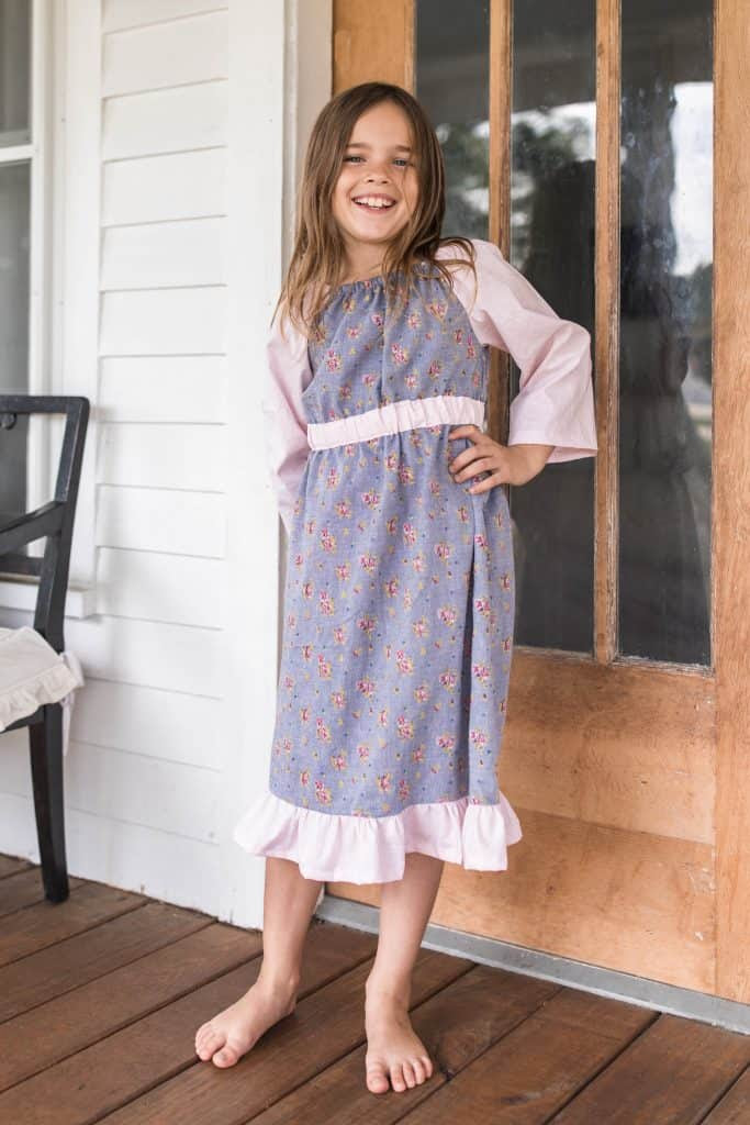 girl in a floral long sleeve peasant dress - dress patterns for girls