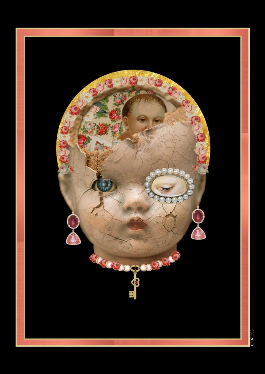 Face of a doll on a black background framed by a rectangular pink frame. The doll's face is cracked and collaged over with decorative roses and pearls, the doll is wearing hanging gem earrings and a necklace decorated with a heart shaped key.