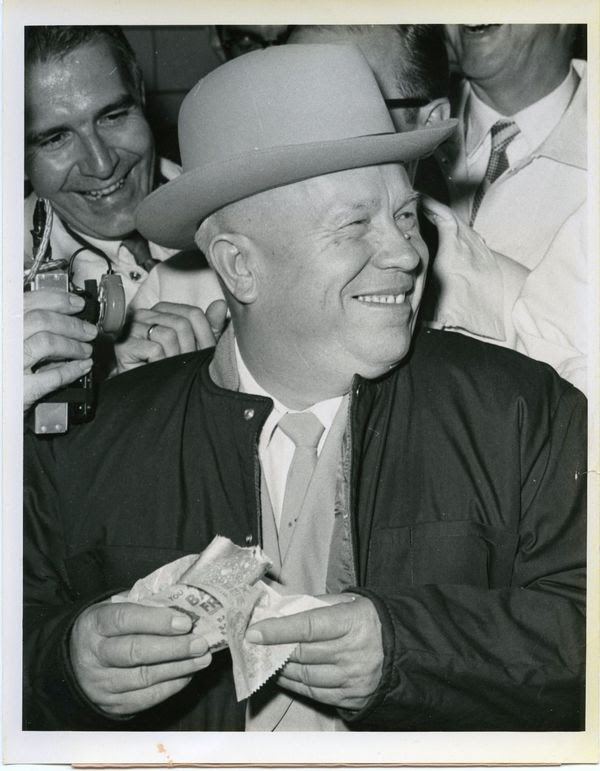 Soviet                                                           Premier Nikita                                                          Khrushchev                                                          eating a hot                                                          dog in Des                                                          Moines, Iowa