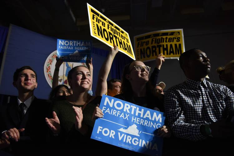 Supporters of Ralph Northam look on as he speaks at his victory rally at George Mason University in Fairfax. (Michael Robinson Chavez/The Washington Post)