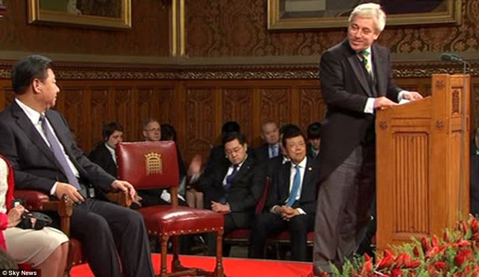 Controversial: Mr Bercow, right, praised pro-democracy campaigner Aung San Suu Kyi during as he introduced president Xi, left