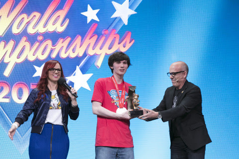 Nintendo of America Senior Vice President of Sales & Marketing Doug Bowser awards winner Thomas Gond ...