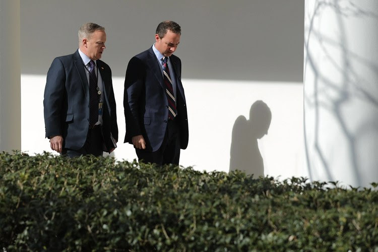 Sean Spicer and Reince Priebus take a walk down the West Wing Colonnade on Friday. (Chip Somodevilla/EPA)</p>