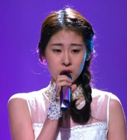 25-year-old girl Zhang bi chen(张碧晨) is the final crowning champion winner of the Voice of China season 3, 2014 year.