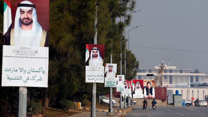 Motorcyclists ride past billboards showing the portraits of Abu Dhabi's Crown Prince Mohammed bin Zayed and Pakistani Prime Minister Imran Khan, to welcome the crown prince to Islamabad, Pakistan, Jan. 6. (AP Photo/Anjum Naveed)
