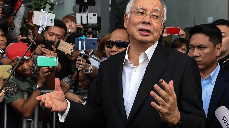 Malaysia's former prime minister Najib Razak after being questioned by the Malaysian Anti-Corruption Commission. Photo: AFP