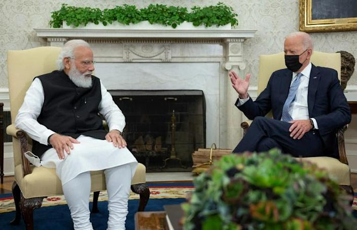 US President Joe Biden meets with Indian Prime Minister Narendra Modi ahead of the Quad meeting in the White House (AFP/Jim WATSON)