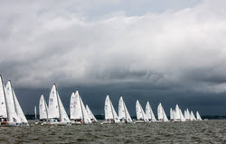 J/70s sailing before storm front