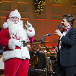Boston Pops Conductor Keith Lockhart with Santa Claus [Photo by Winslow Townson]