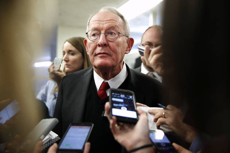Sen. Lamar Alexander (R-Tenn.) speaks to reporters as he heads to vote on budget amendments. (Jacquelyn Martin/AP)