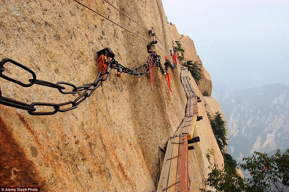 Stomach-jolting: You have to have nerves of steel to risk death or                                                      serious injury                                                      when you take on                                                      one of the world's                                                      most dangerous                                                      trails - Mount Hua                                                      in China. It                                                      features                                                      stomach-churning                                                      drops, vertical                                                      ascents, steep                                                      staircases and                                                      narrow walkways,                                                      with only a small                                                      chain to cling                                                      onto