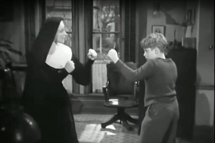 Sister Mary Benedict (Ingrid Bergman) gives a boxing lesson in 'The Bells of St. Mary's' (1945).