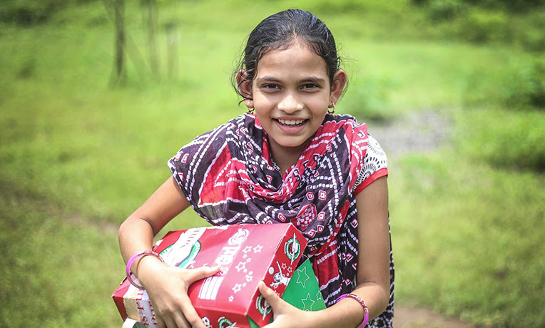 A Child With A Shoebox From The Country Your Shoebox Was Sent To