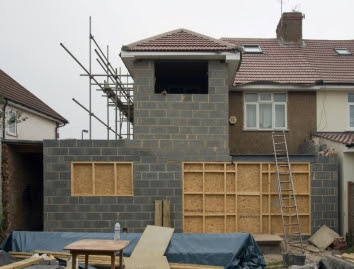 A picture containing building, outdoor, house, area Description automatically generated
