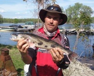Image of a man holding a Lake St. Pierre sauger.