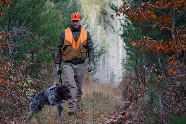 DNR Director Dan Eichinger is shown on a hunting walk with his dog.