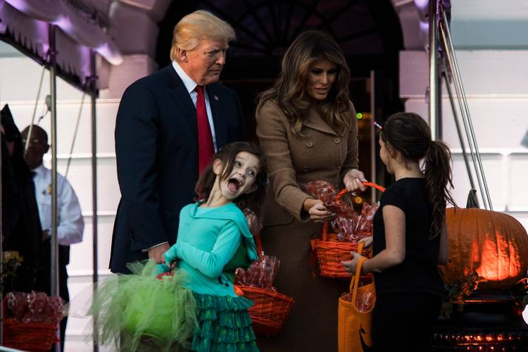 President Trump and first lady Melania Trump hand out treats to the children of military families for Halloween. (Jabin Botsford/The Washington Post)