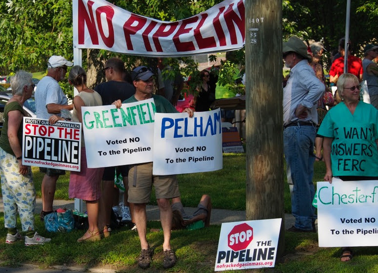 Protesters with Stop the Pipeline signs