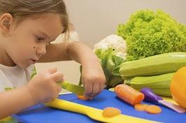 young girl preparing vegetables