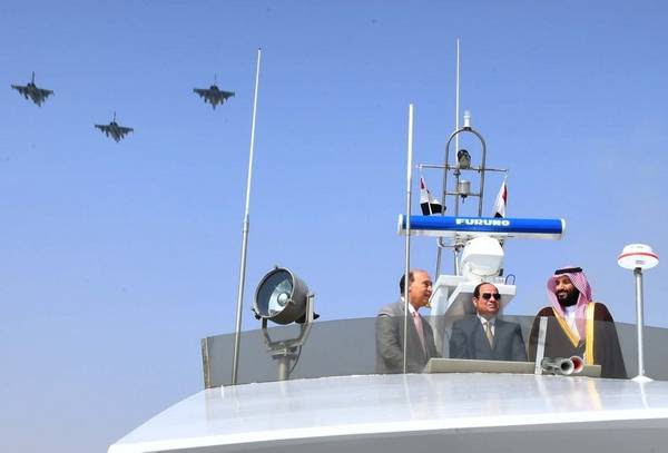 Mohammed bin Salman, with Egyptian President Abdel Fatah al-Sissi, surveying projects in Ismailia, Egypt, on March 5. (The Egyptian Presidency/Reuters)