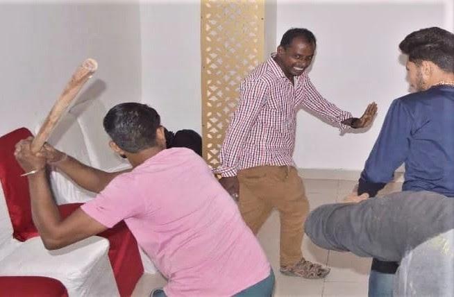 Hindu extremists assault a Christian (not visible) in Agra, Uttar Pradesh, India. (Morning Star News)