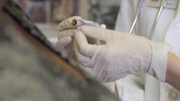 clinician testing HIV vaccine