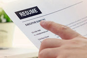 Photo of hand pointing at resume