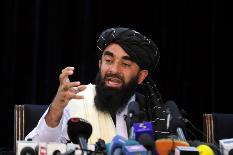 'We have expelled the foreigners and I would like to congratulate the whole nation on this,' Taliban spokesman Zabihullah Mujahid said in Kabul, Afghanistan [Rahmat Gul/AP Photo]