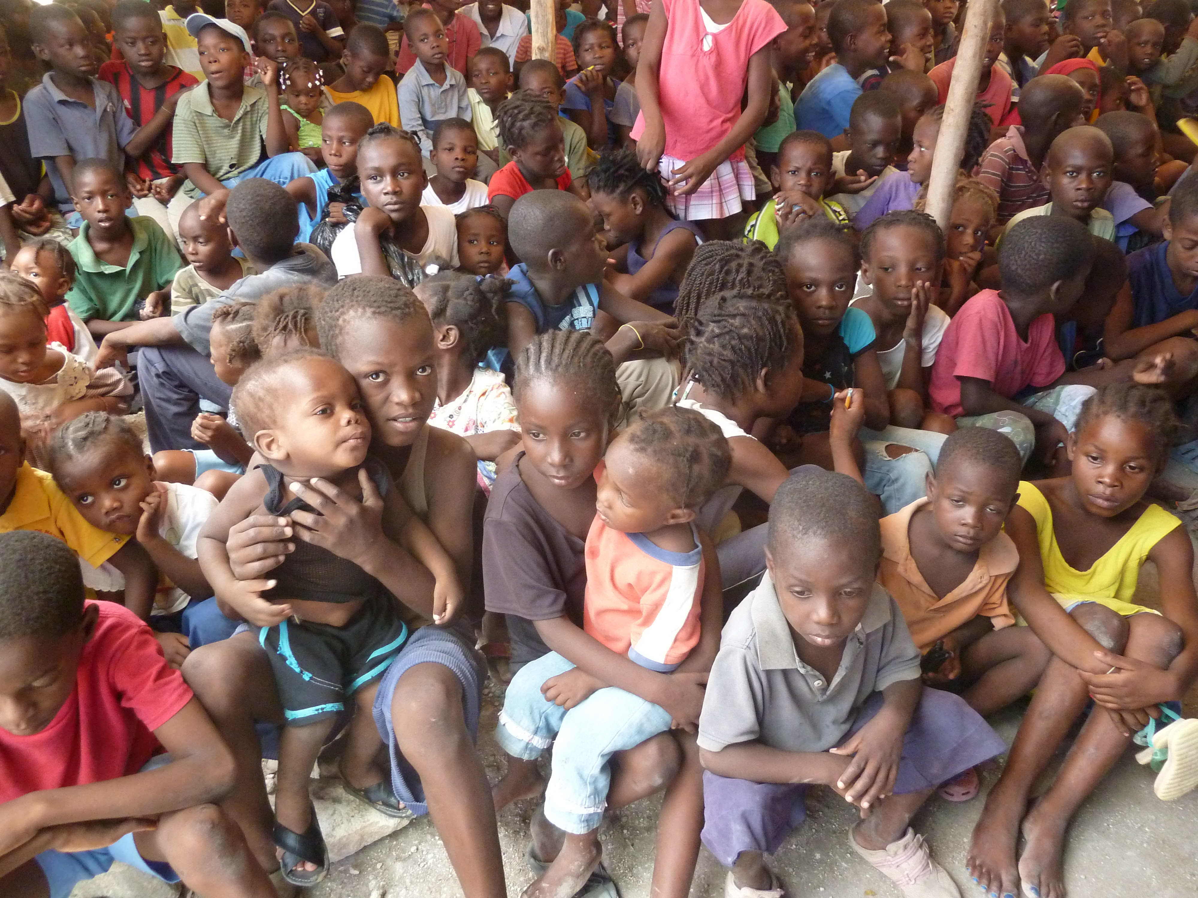 children waiting at food program