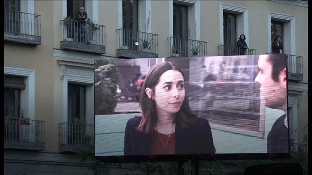 Coronavirus: Madrid's balcony cinema screens films for people in lockdown