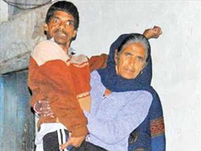 Neero Devi, 62, with her son Raj Kumar. 30-year-old Kumar's Aadhaar card is yet to be made as biometric machines have failed to record his fingerprints or iris scan even after four attempts.