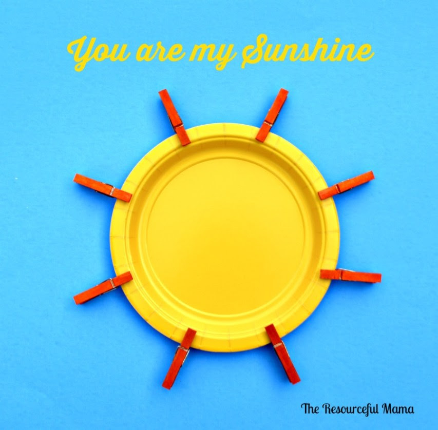 You are my sunshine paper plate and mini clothespin sun kid craft project.