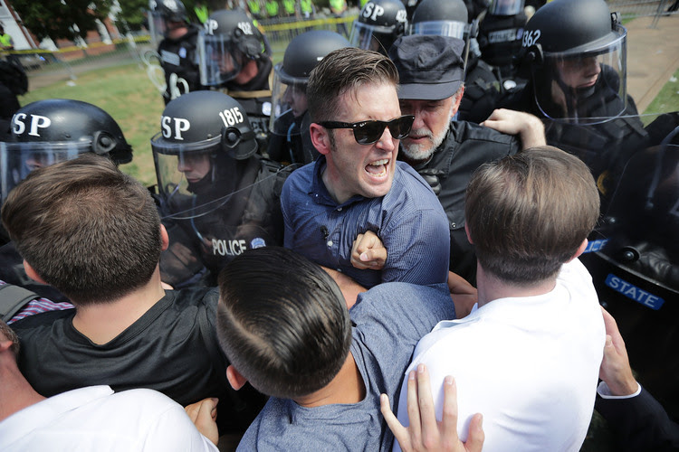 "White nationalist Richard Spencer and his supporters clash with Virginia State Police in Lee Park after the ""United the Right"" rally was declared an unlawful gathering on Saturday in Charlottesville. (Chip Somodevilla/Getty Images)"