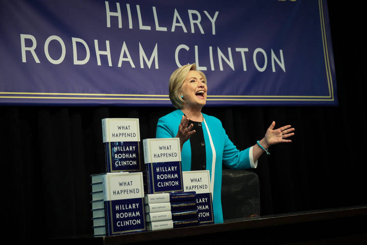 "Hillary Clinton signs copies of her new book, ""What Happened,"" at Barnes & Noble in New York. (Drew Angerer/Getty Images)"