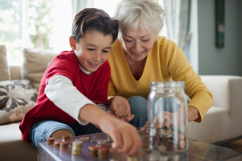 Older woman and child counting change