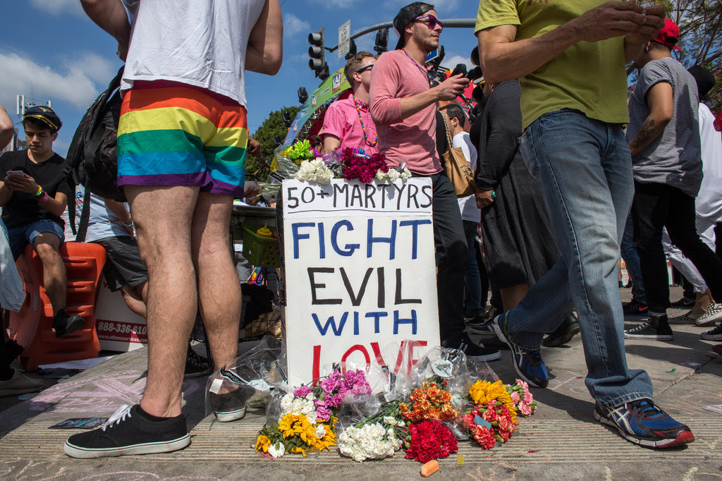 Thousands of people attended a gay pride parade in Los Angeles on Sunday in the wake of the mass shooting at a gay nightclub in Orlando, Fla..