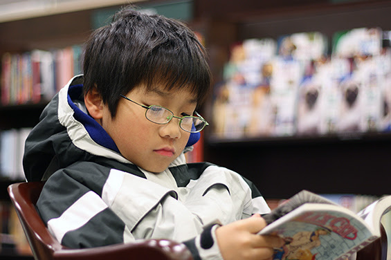 Photo of young student reading