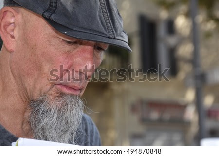 Marseille, France - October 06, 2016 : French cartoonist Jean-Michel Gruet at the 5th edition of the International festival of press and political cartoons at l'Estaque.