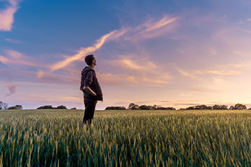 Person standing in a field