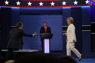 Hillary Clinton shook hands with the moderator, Chris Wallace, on Wednesday before the debate at the University of Nevada, Las Vegas, a gesture that was not repeated with Donald J. Trump.