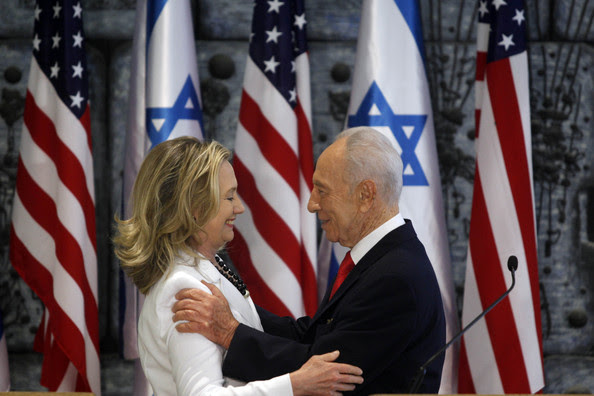 (ISRAEL OUT) Israeli President Shimon Peres (R) and US Secretary of State Hillary Clinton speak after a joint press conference on July 16, 2012 in Jerusalem, Israel. Clinton is in Israel to discuss diplomacy with Iran, Syria and Egypt in addition to peace talks regarding the Middle East.